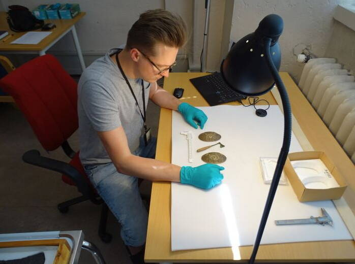 Researcher Examining Warrior Remains