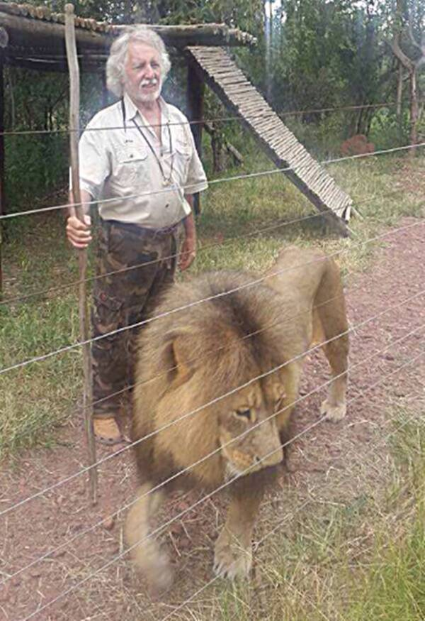Game Reserve Owner With Lion