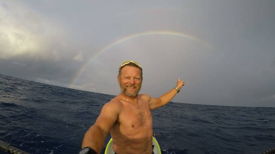Antonio de la Rosa Points To Rainbow At Sea