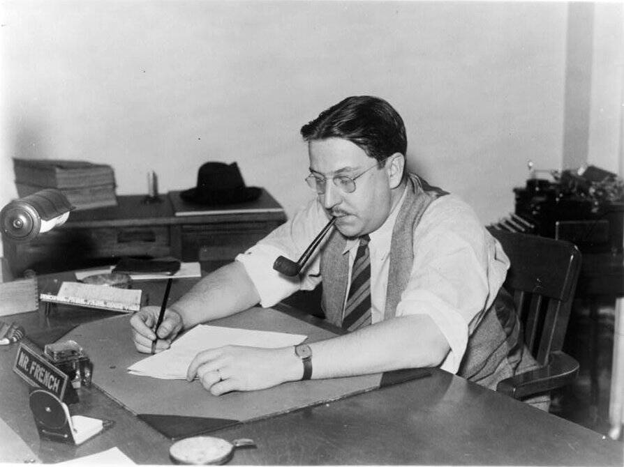 Paul French Writing At A Desk