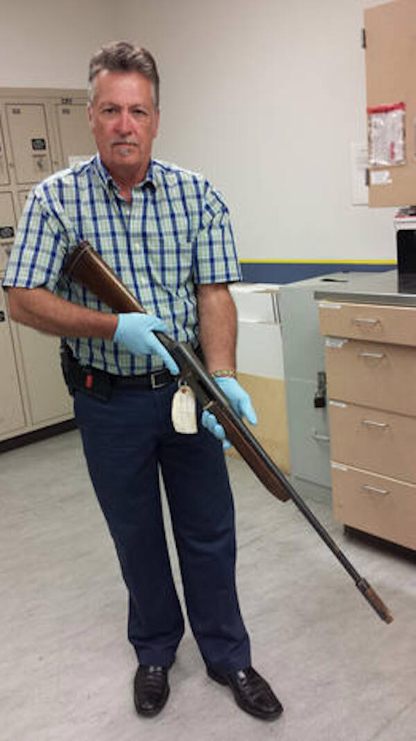Police Officer Holding Kurt Cobain's Shotgun