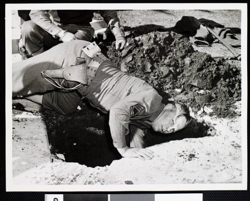 Army Sergeant Digging For A Shell In Los Angeles