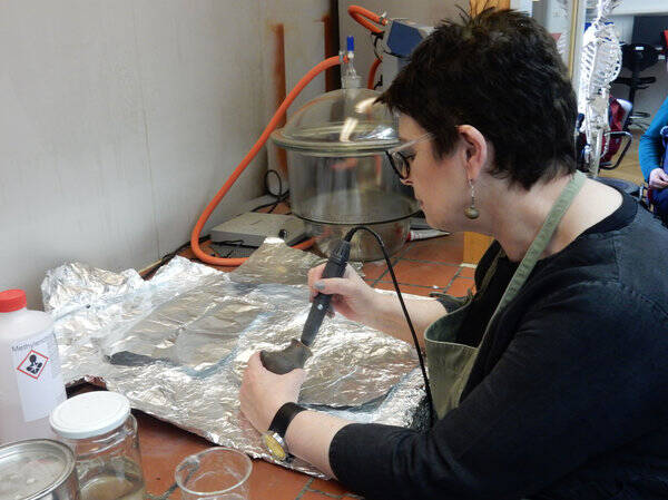 Julie Dunne Examining Baby Bottles