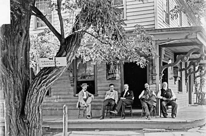 Men Sitting In Front Of Saloon