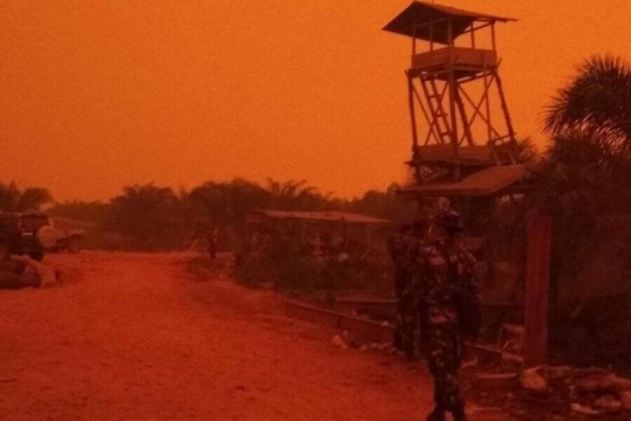 Soldier Walks Through Red Haze