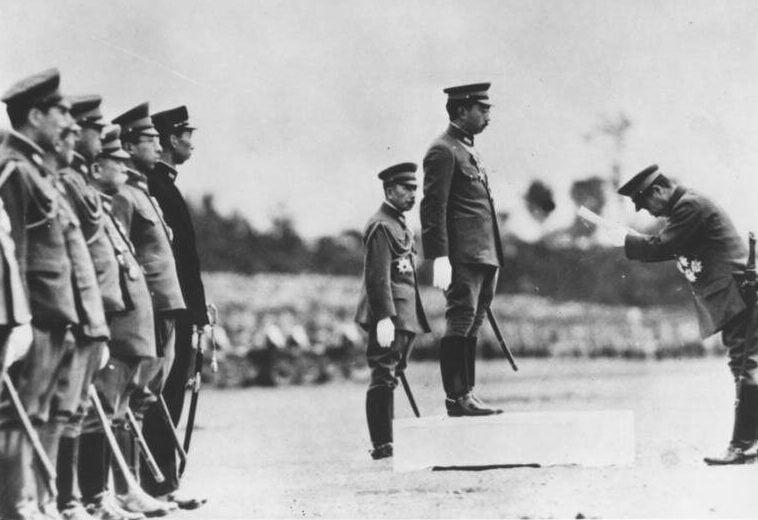 Tojo Bowing To Hirohito