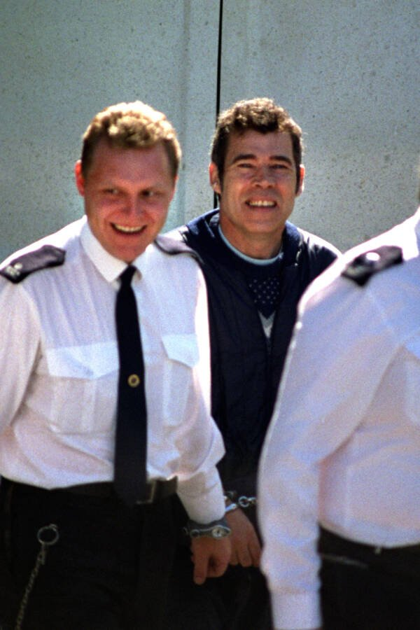 Fred West Handcuffed And Smiling