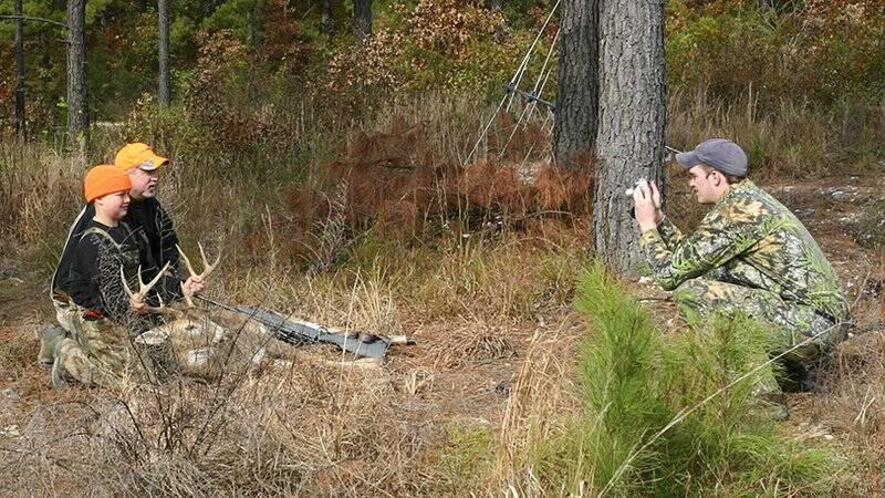 Hunters Posing With Dead Buck