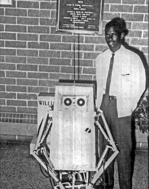 Lonnie Johnson Beside His First Robot
