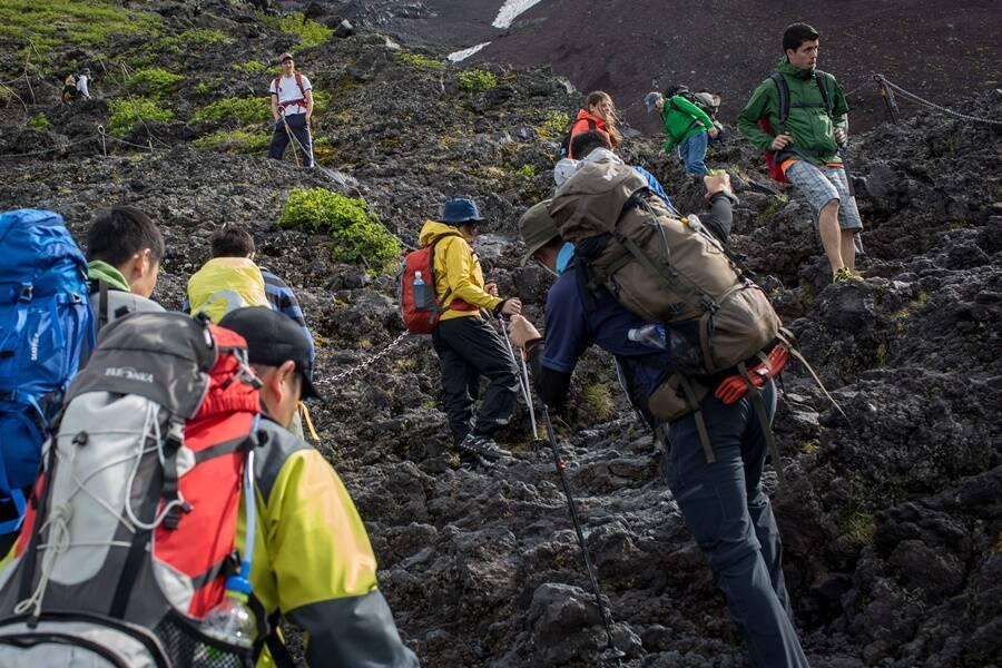 Tourists Climbing Mount Fuji