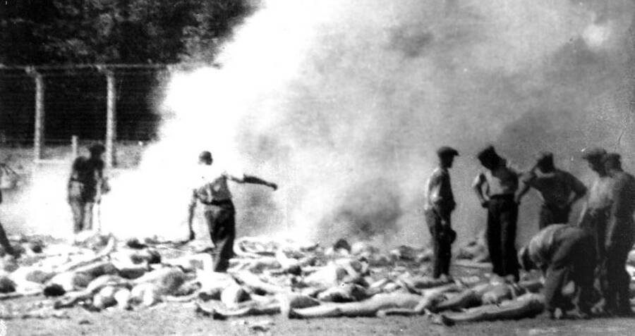 Sonderkommandos And Kapos Disposing Of Bodies At Auschwitz