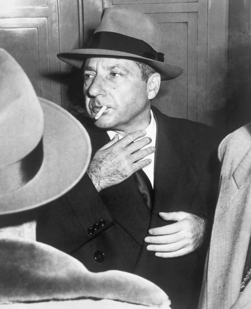 Frank Costello Smokes A Cigarette