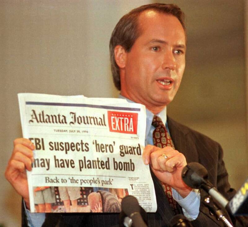 Lin Wood Holds Newspaper With Olympic Park Bombing Headline