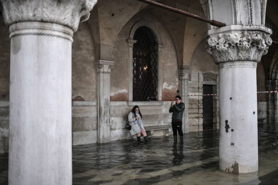 Tourists Photographing Venice Flood