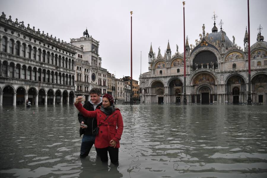Tourists Selfie In Venice Flood