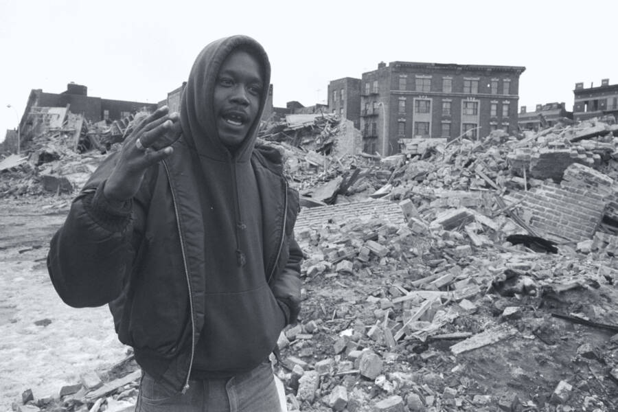 Bronx Citizen Walking By Rubble
