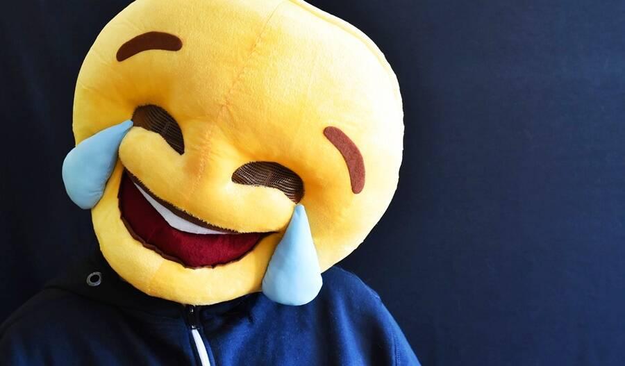 Man Wearing Plush Laughing Emoji Head