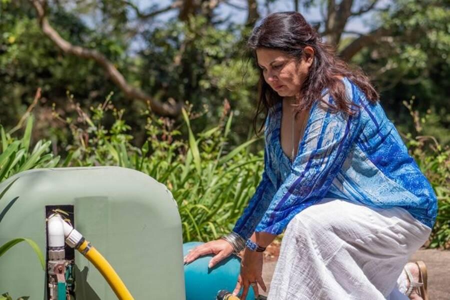 Woman Filling Water Jug