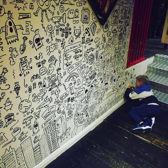 Doodle Boy Doodling On The Floor