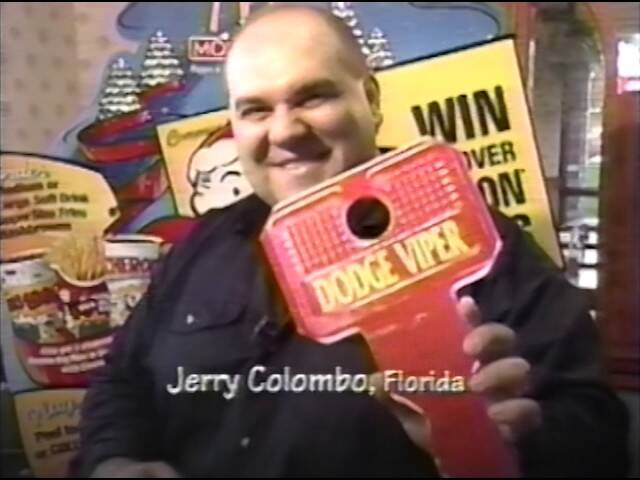 Jerry Colombo Holding McDonald's Monopoly Card