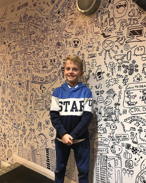 Joe Whale With His Doodle Wall