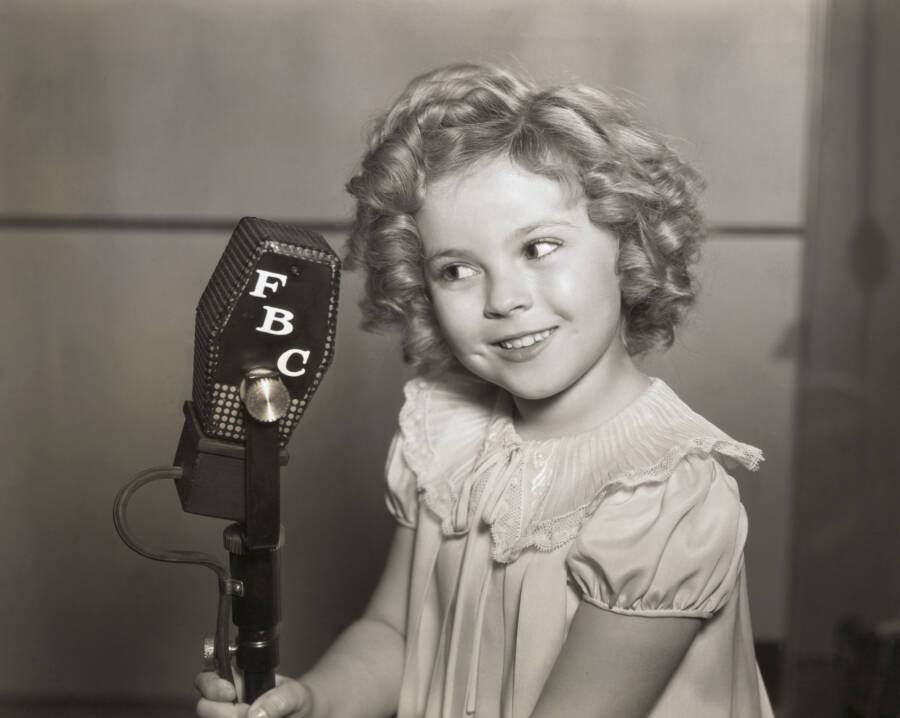 Shirley Temple Smiling At Mic