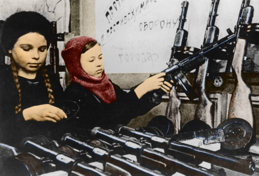 Young Girls Assembling Rifles