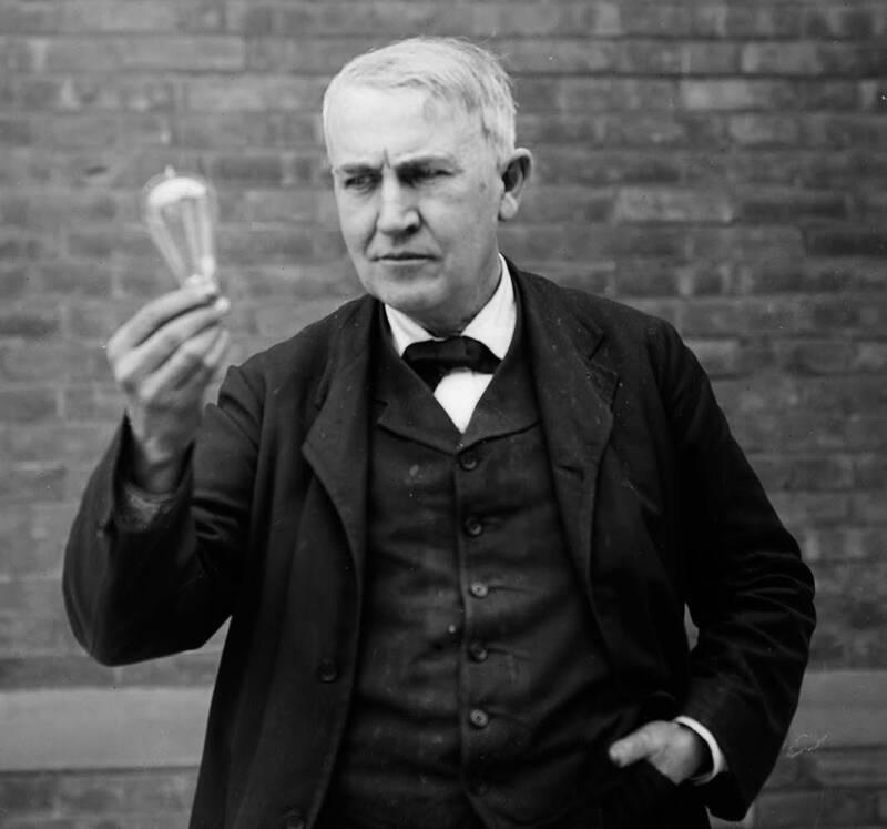 Edison Holds Up A Lightbulb