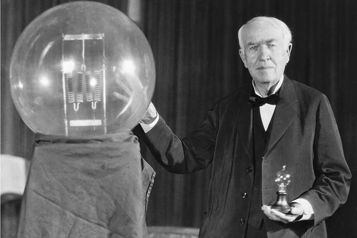 Edison Touching Giant Light Bulb Featured