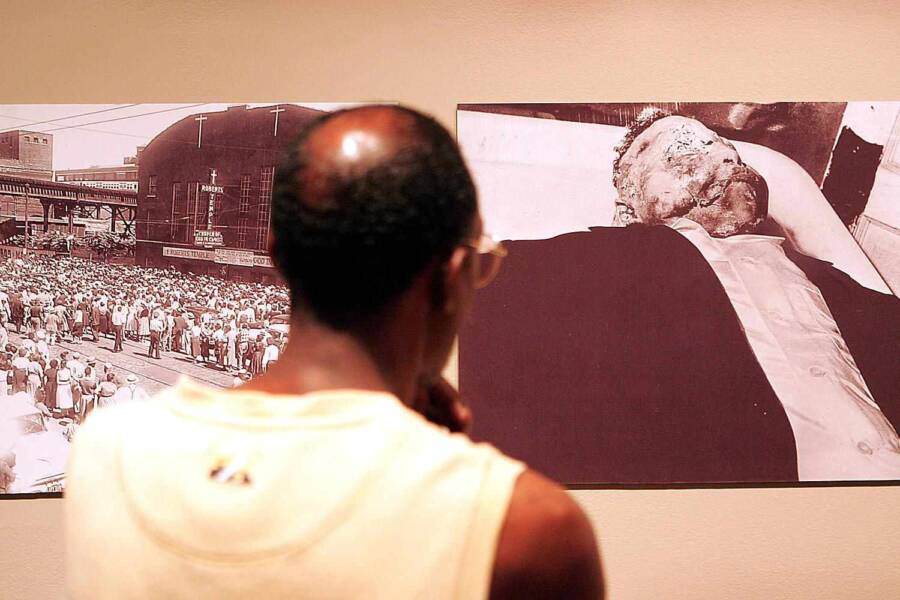 Man Looking At Emmett Till Photo