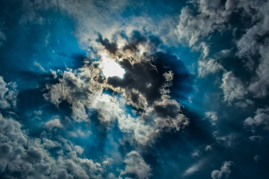 Sun Shining Through The Clouds