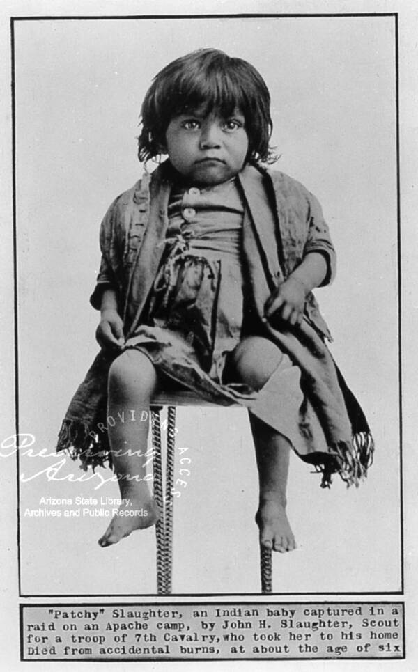 Apache Child Seated For A Portrait