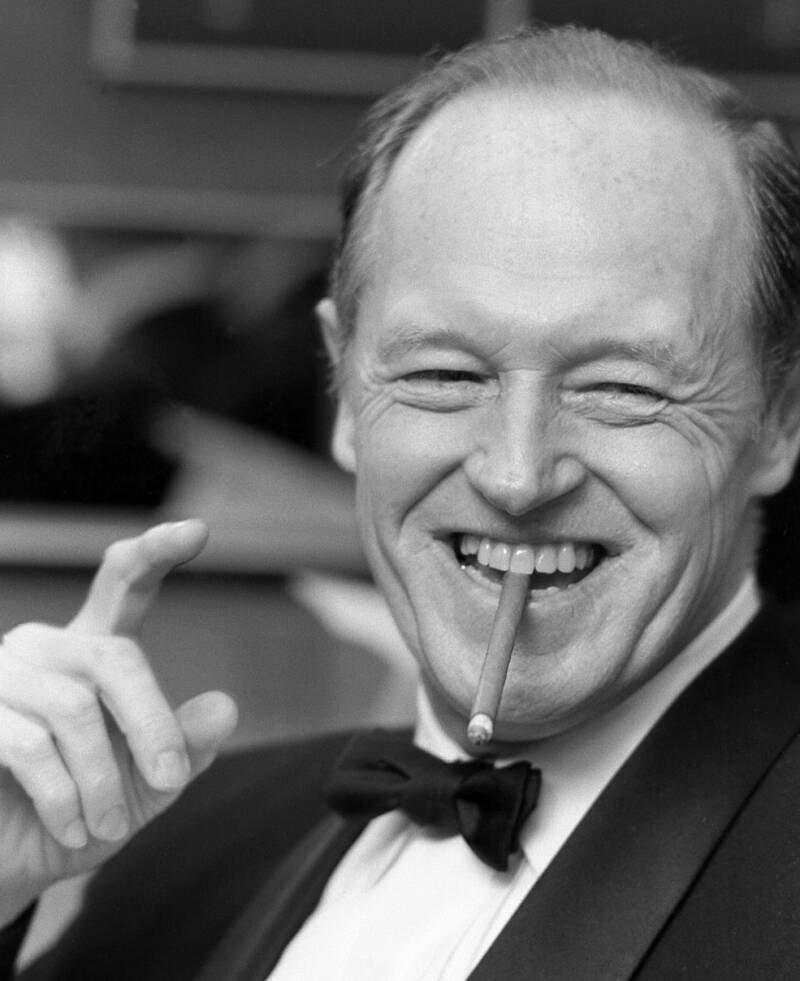 E Howard Hunt Smoking A Cigar