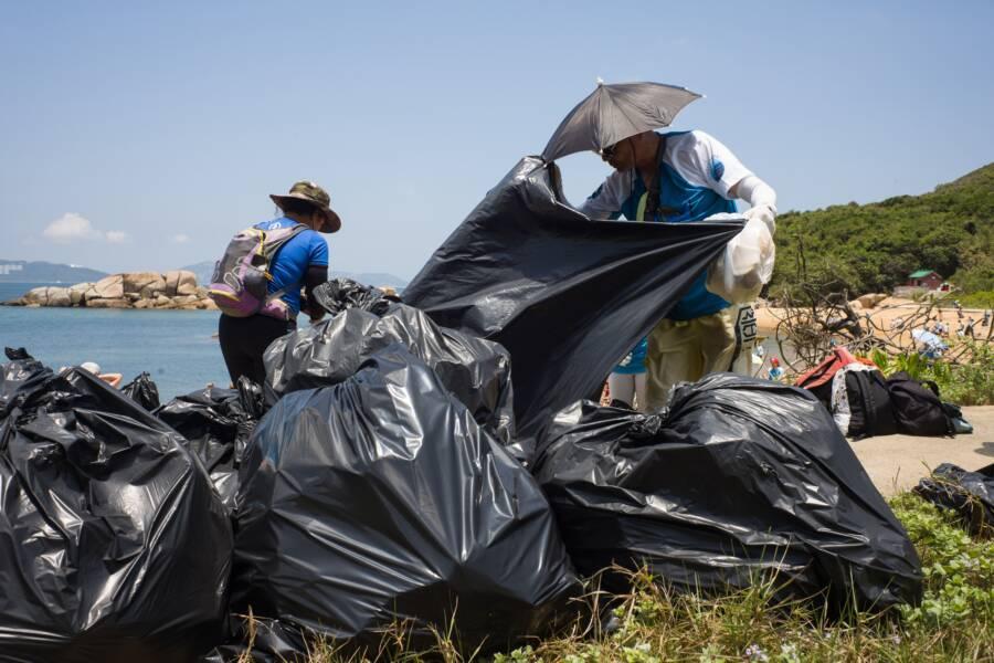 Environmentalists Cleaning Hong Kong Beach