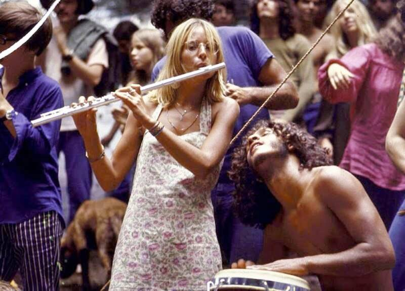 Woman Playing The Flute At Woodstock