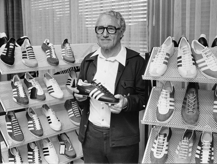 Adolf Dassler Holding Sneakers