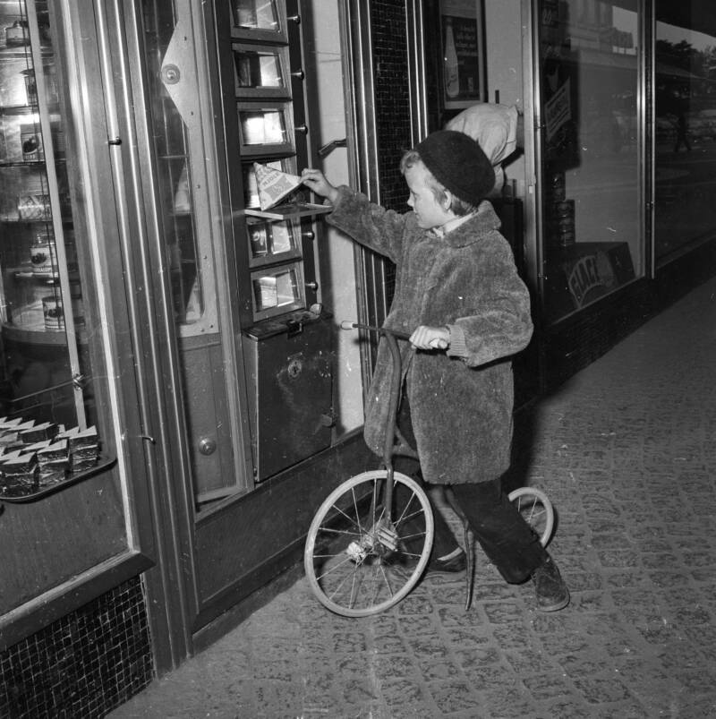 Boy Buying Milk From An Automat