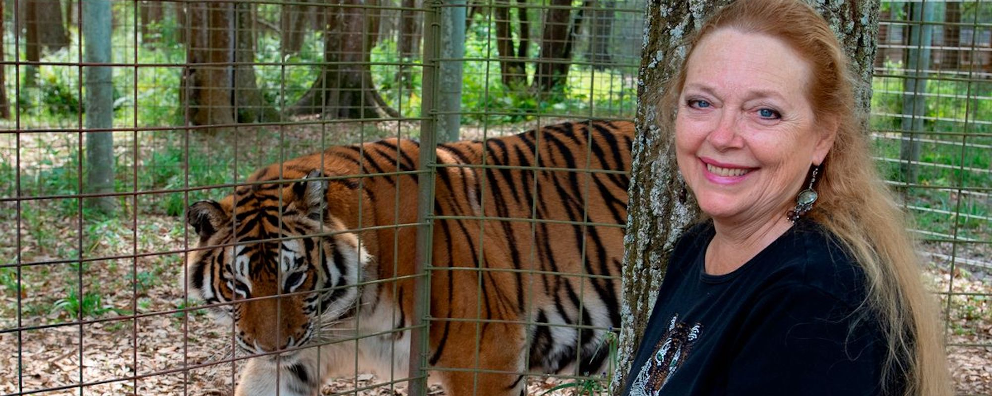 Carole Baskin Smiling With A Tiger