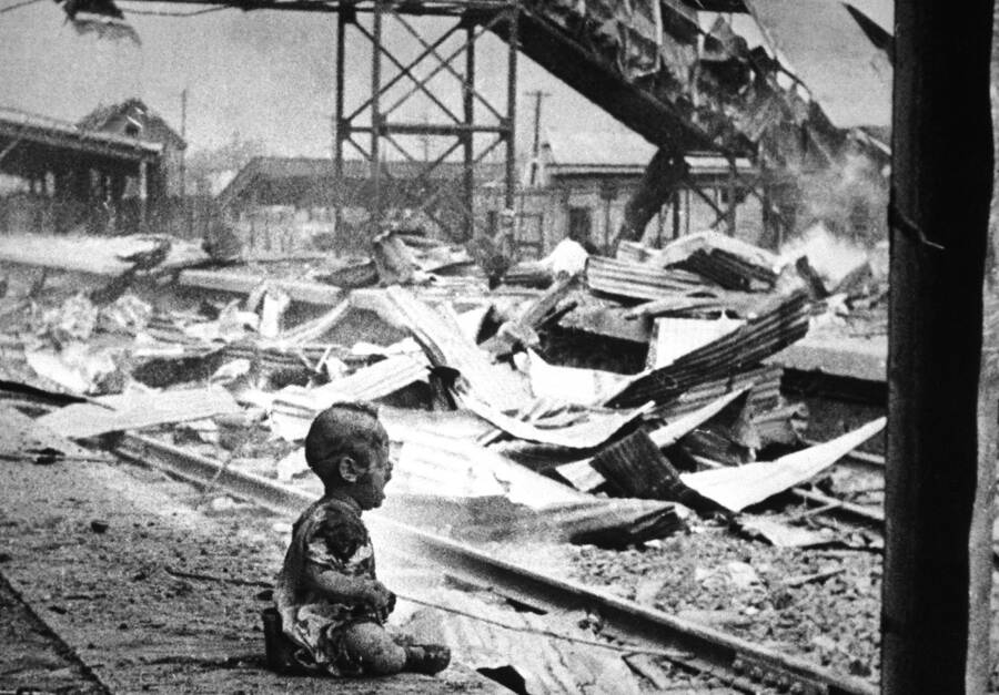 Crying Chinese Baby In Shanghai Ruins