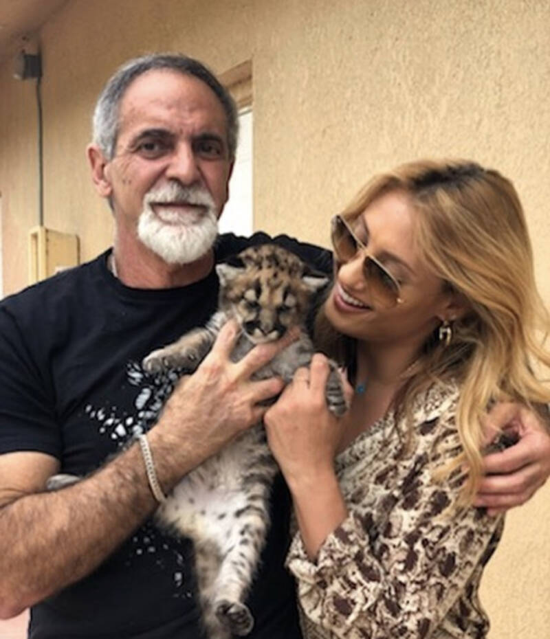 Mario Tabraue And His Wife Hold A Tiger