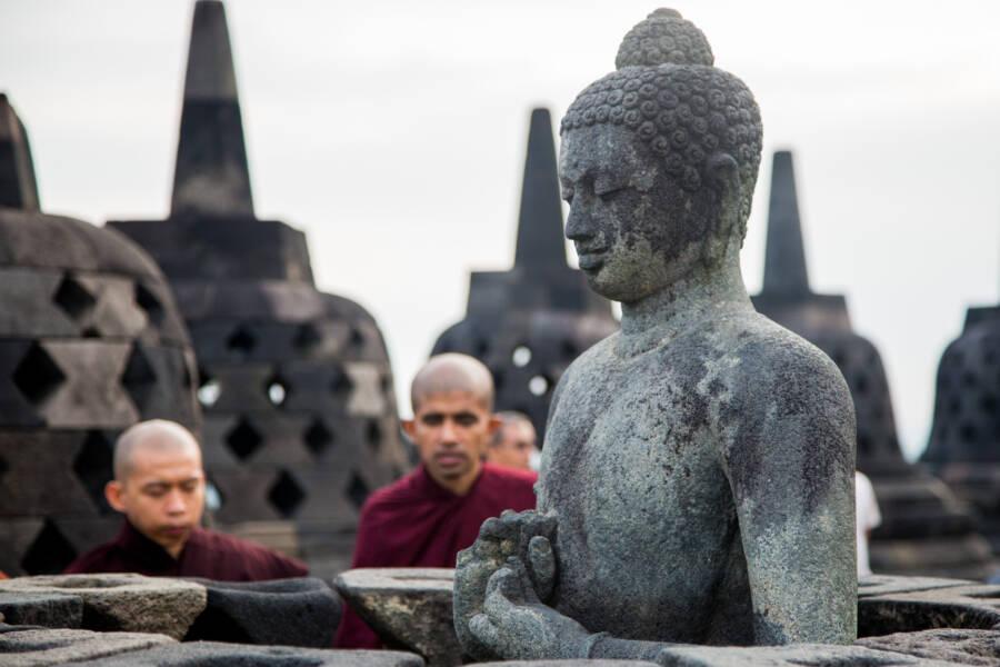 Monks And Buddha Statue