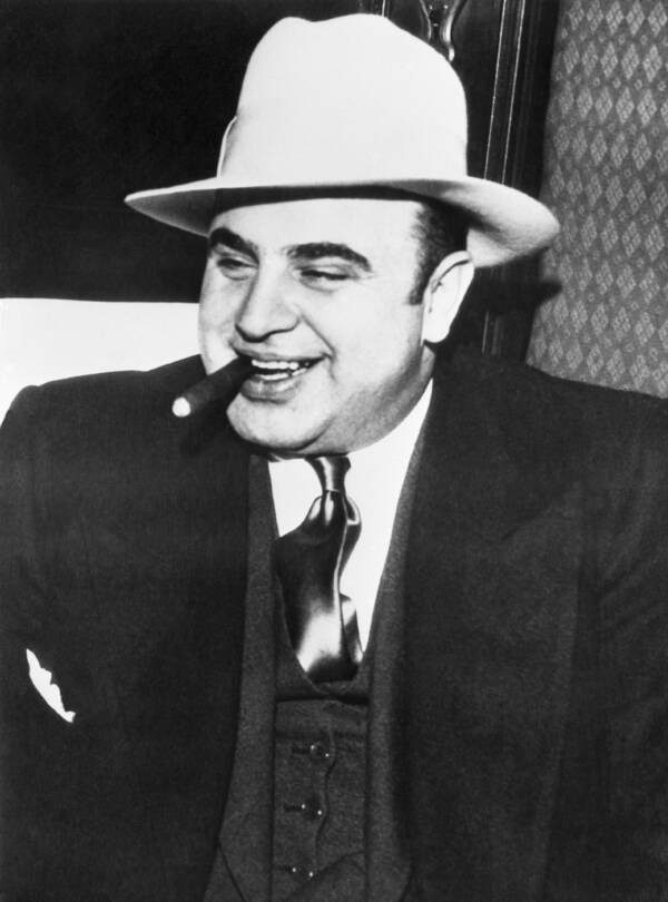 Al Capone Chomping On A Cigar And Smiling