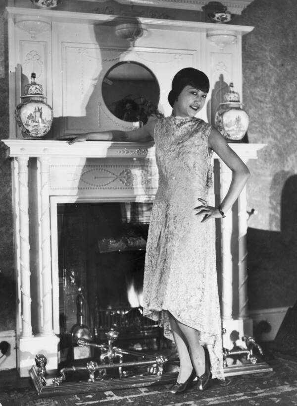 Anna May Wong Posing In Front Of Fireplace