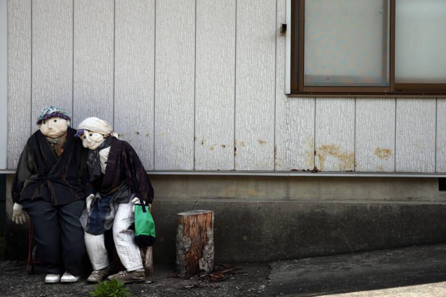 Dolls Outside Abandoned House