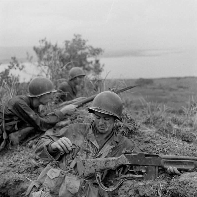 Soldier Loads Gun