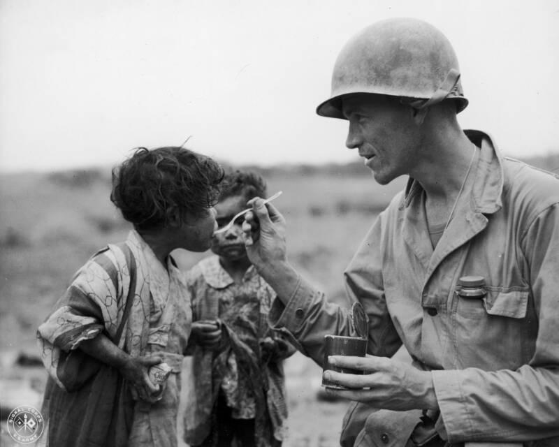 Soldier Shares Food Kids