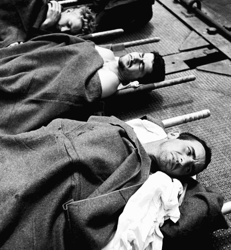 Wounded Soldiers On Stretchers