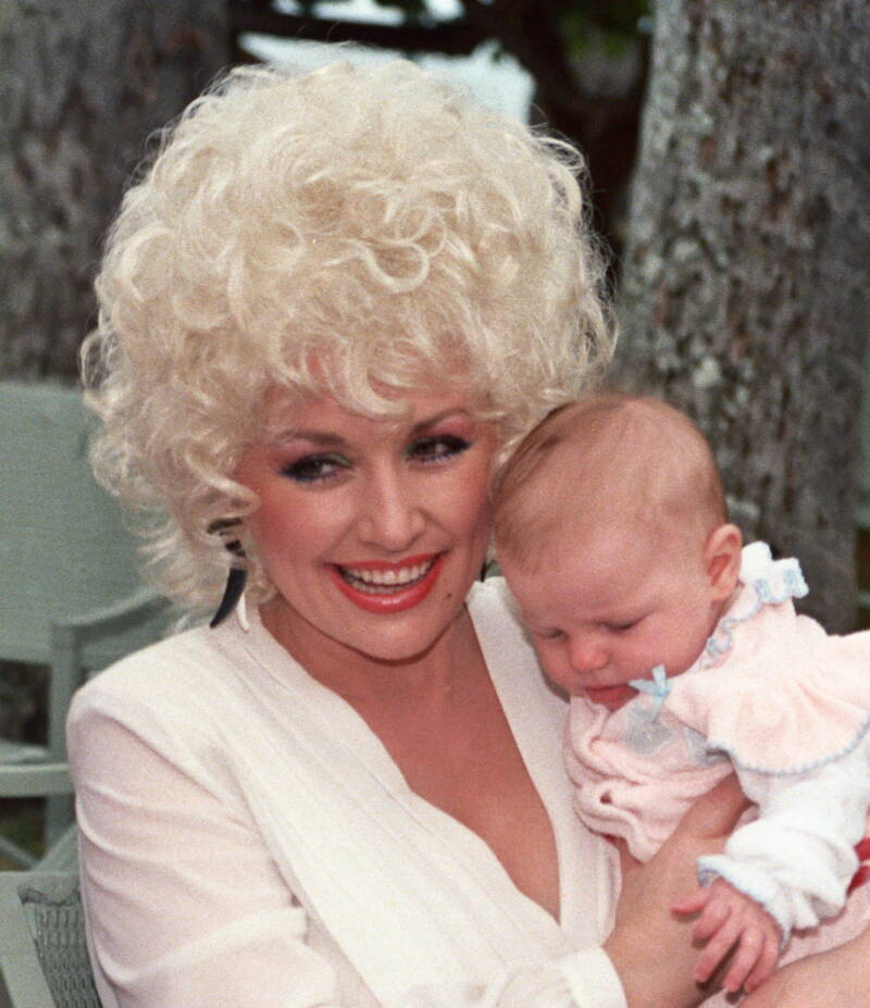Dolly Parton Holding A Baby