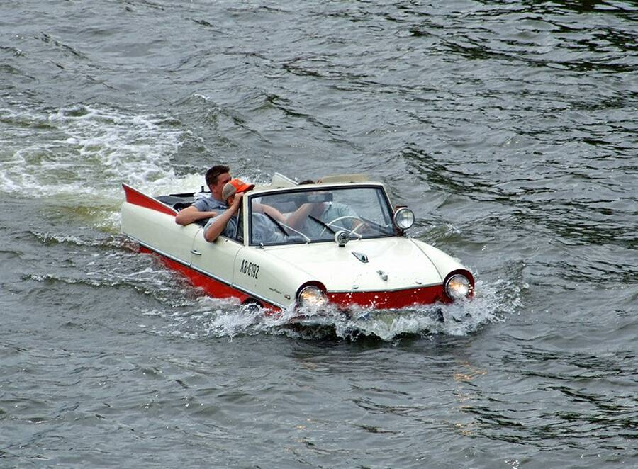Man Driving An Amphicar In Water