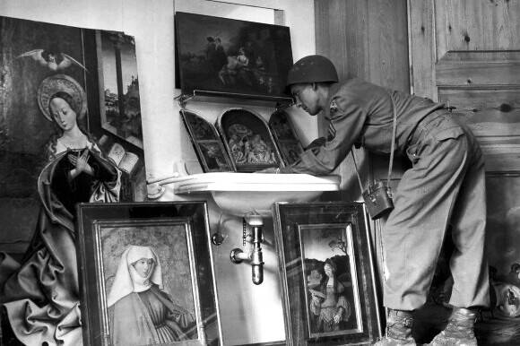 Monuments Man Leaning Over Recovered Painting